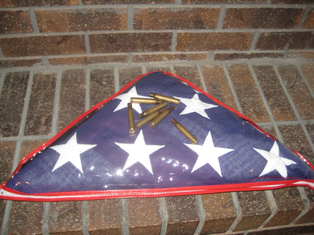 American flag with spent shell casings