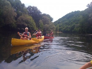Rebecca & Marie followed by Tom, canoeing on the Dordogne