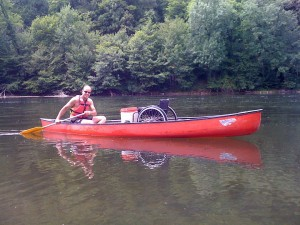 Tom with my wheelchair, canoeing on the Dordogne