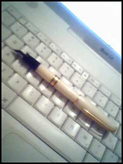 pen resting on keyboard