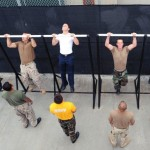 Sailors perform pull ups