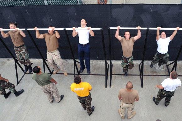 Sailors perform pull ups